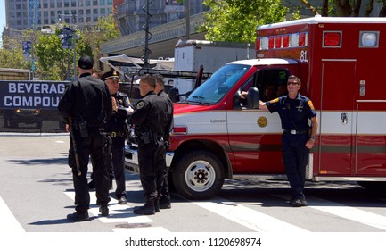 San Francisco, CA - June 23, 2018: SFPD officers and EMS standing by at San Francisco Pride Festival, one of the largest gatherings of the LGBTQ Community and its allies in the nation.