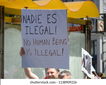 SAN FRANCISCO, CA JUNE 23, 2018: Pro-immigration sign on display by a marcher in a LBGT pride parade. No human being is illegal.