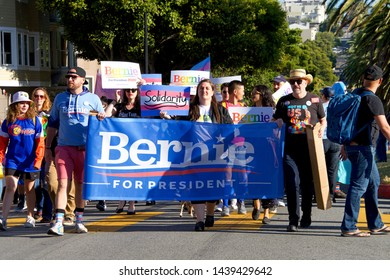 San Francisco, CA - June 28, 2019: Unidentified participants holding a signn for Bernie Sanders, participating in the 16th annual Trans March, a celebration of trans and gender non-conforming people.
