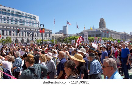 "San Francisco, CA - June 30, 2018: Thousands of protestors in a ""Families Belong Together"" march to City Hall, protesting Trump's ""Zero Tolerance"" policy and the separation of more that 2,000 children"