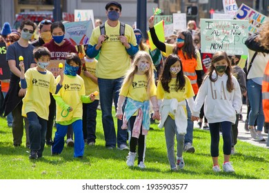 San Francisco, CA - Mar 13, 2021: Unidentified participants at the Open the Schools Rally at Civic Center in front of City Hall, holding signs in protest of schools still being closed in the city.