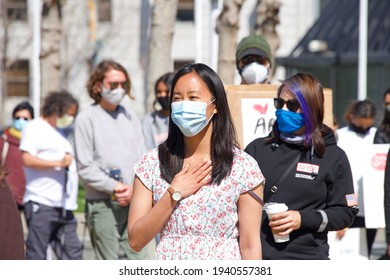 San Francisco, CA - Mar 21, 2021: Melanie Gin leading unidentified participants walking at the Sit, Walk, Listen rally at Civic Center after the Atlanta spree shooting of women in Atlanta.