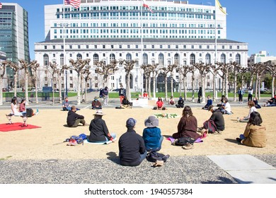 San Francisco, CA - Mar 21, 2021: Unidentified participants at the Sit, Walk, Listen rally at Civic Center after the Atlanta spree shooting of women in Atlanta.