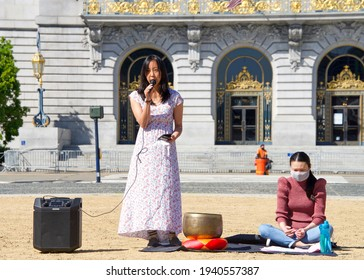 San Francisco, CA - Mar 21, 2021: Melanie Gin, one of the founders of Sit, Walk, Listen speaking at a rally after the Atlanta spree shooting.