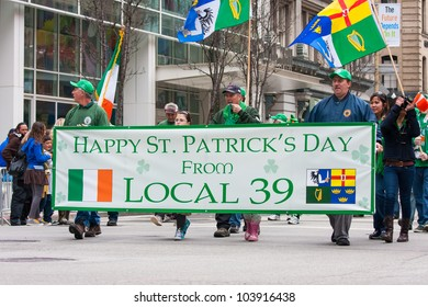 SAN FRANCISCO, CA - MARCH 17: Men holding a banner during the St. Patric's Day Parade. March 17, 2012 in San Francisco, CA