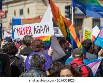 SAN FRANCISCO, CA - MARCH 24, 2018: Never again sign at March for Our Lives rally in San Francisco. The rally was one of dozens nationwide that was sparked by the Stoneman Douglas school shootings.