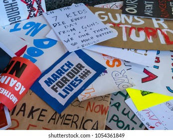 SAN FRANCISCO, CA - MARCH 24, 2018: Pile of various discarded signs for the March for Our Lives rally in San Francisco. Sparked by the Stoneman Douglas school shootings