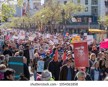 SAN FRANCISCO, CA - MARCH 24, 2018: Protesters march at March for Our Lives rally in San Francisco. The rally was one of dozens nationwide that was sparked by the Stoneman Douglas school shootings.