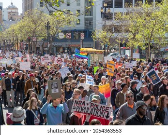 SAN FRANCISCO, CA - MARCH 24, 2018: Anti-gun and anti-NRA march at March for Our Lives rally. The rally was one of dozens nationwide that was sparked by the Stoneman Douglas school shootings.