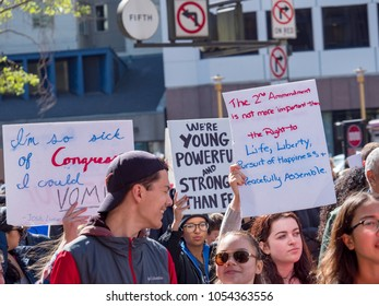 SAN FRANCISCO, CA - MARCH 24, 2018: Protesters march with various signs at March for Our Lives rally. The rally was one of dozens nationwide that was sparked by the Stoneman Douglas school shootings.
