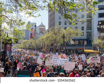 SAN FRANCISCO, CA - MARCH 24, 2018: Marchers at March for Our Lives rally in traverse down Market Street in San Francisco. The rally was sparked by the Stoneman Douglas school shootings.