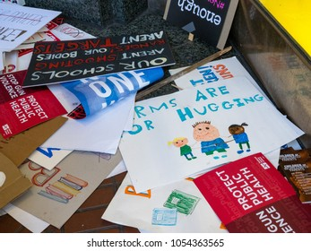 SAN FRANCISCO, CA - MARCH 24, 2018: Various discarded signs for the March for Our Lives rally in San Francisco. The rally was sparked by the Stoneman Douglas school shootings.