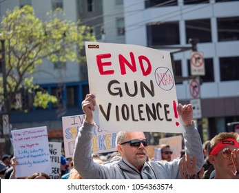 SAN FRANCISCO, CA - MARCH 24, 2018: End gun violence, anti NRA sign at March for Our Lives rally in San Francisco. The rally was sparked by the Stoneman Douglas school shootings.