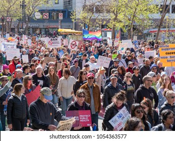 SAN FRANCISCO, CA - MARCH 24, 2018: Marchers with pro-peace signs at March for Our Lives rally in San Francisco. The rally was sparked by the Stoneman Douglas school shootings.