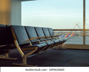 SAN FRANCISCO, CA – May 10, 2018: Empty seats at SFO airport with Southwest planes in background