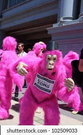 """SAN FRANCISCO, CA - MAY 12: Colorful pink """"gorillas"""" promote the famous Zazzle Bay-to-Breakers Race to tourists at the Embarcadero on May 12, 2012,  in San Francisco, California."""