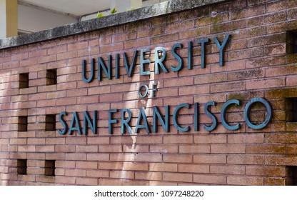 San Francisco, CA - May 19, 2018: University of San Francisco bronze sign on brick wall.
