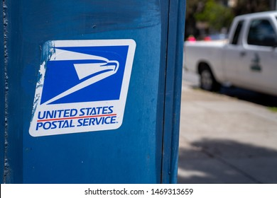 San Francisco, CA MAY 19, 2019: United States Postal Service USPS, logo and on mail box on sidewalk