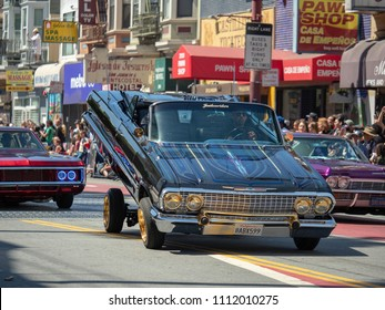 SAN FRANCISCO, CA – MAY 27, 2018: Man demonstrating his hydraulic low rider at the Carnaval Grand Parade in San Francisco's Mission District