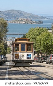 SAN FRANCISCO Ca. - MAY 6: Passengers ride in a cable car on May 6, 2010 in San Francisco. It is the most popular way to get around the City of San Fransisco.