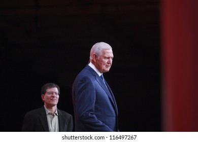 SAN FRANCISCO, CA, OCT 1, 2012 - Legendary American basketball player Jerry West (right) welcomes Oracle OpenWorld conference in Moscone center on Oct 1, 2012 in San Francisco, CA