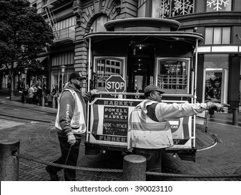 San Francisco, CA - Oct 28, 2015: A cable car being rotate on turntable by gripmen. Some San Francisco's cable car run only in one direction, so they need to be rotate at end of line on a turntable.