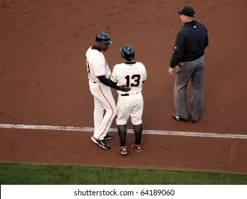 SAN FRANCISCO, CA - OCTOBER 20: Roberto Kelly talks to Cody Ross after he was hit by a pitch game 4 of the 2010 NLCS between Giants and Phillies Oct. 20, 2010 AT&T Park San Francisco, CA.