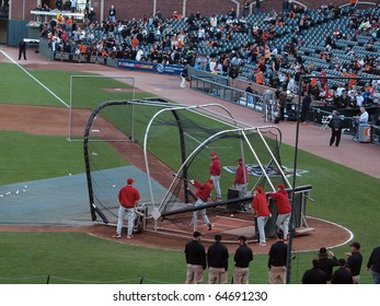 SAN FRANCISCO, CA - OCTOBER 20: Phillies players take batting practice before game, player in mid-swing, game 4 2010 NLCS between Giants and Phillies Oct. 20, 2010 AT&T Park San Francisco, CA.