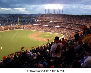 SAN FRANCISCO, CA - OCTOBER 28: Giants fans cheer waving rags in anticipation of upcoming pitch game 2 of the 2010 World Series game between Giants and Rangers Oct. 28, 2010 AT&T Park San Francisco.