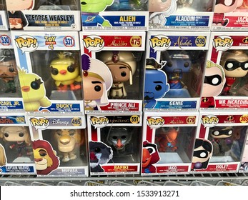 San Francisco, CA - October 6, 2019: POP brand bobble heads featuring different cartoon characters from popular movies in boxes inside a gift shop in Chinatown.