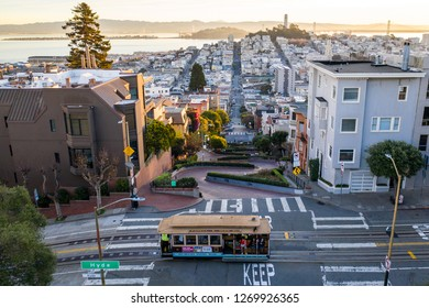 San Francisco, CA / United States - Dec 29, 2018: Lombard Street during sunrise with cable car
