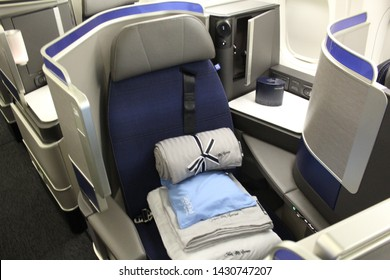 San Francisco, CA / United States – April 25, 2018: United Polaris Business Class seat as found on a United Airlines Boeing 777 aircraft at San Francisco International Airport.