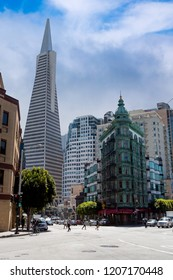 San Francisco, CA / USA - 4/20/2015: Pedestrians Crossing In Front Of Transamerica Pyramid & Zoetrope Cafe