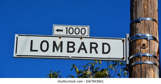 SAN FRANCISCO CA USA APRIL 15: Lombard Street sign is an east-west street in San Francisco California on april 15 2015. The street is known as the most crooked street in the world