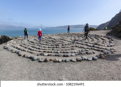 San Francisco, CA, USA - April  01, 2018: People at Land's End Labyrinth created by Eduardo Aguilera in 2004 at Eagle's Point in Lands End park, San Francisco.