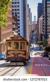 SAN FRANCISCO, CA, USA - APRIL 18, 2019 : View on California Steet with a back drop of the Bay Bridge - San Francisco, CA, USA