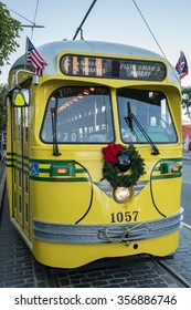 San Francisco, CA, USA -- Dec 15, 2015.  Historic Muni F Line street car decorated with a wreath for the Christmas holiday season.