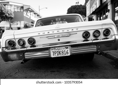 SAN FRANCISCO, CA, USA - FEBRUARY 25, 2018: A low rider classic car tilts to the left with its modified suspension.