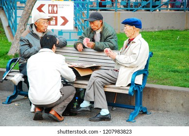 San Francisco, CA, USA January 29 Elderly men enjoy an outdoor card game in Portsmouth Square in San Francisco