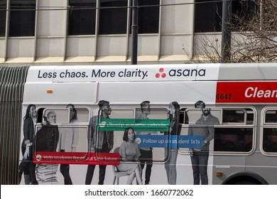 San Francisco, CA, USA - Mar 1, 2020: Bus with Asana advertisement seen in downtown San Francisco. Asana is a web and mobile application designed to help teams organize, track, and manage their work.