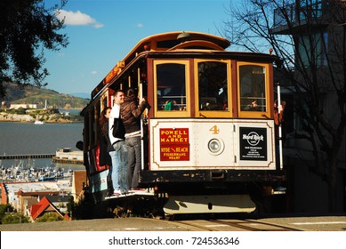 San Francisco, CA, USA March 2, 2009 A cable car full of passengers crests the summit of Russian Hill in San Francisco