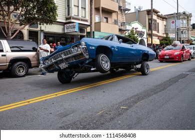 SAN FRANCISCO, CA, USA - MAY 5, 2018: A lowrider cruises through the streets of San Francisco's Mission District.