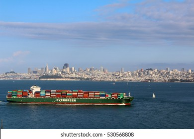 San Francisco, CA, USA - MAY 23, 2015: Cargo ship pass by San Francisco bay on May 23, 2015 in San Francisco. SF is the most densely settled large city in California and the second-most in US.