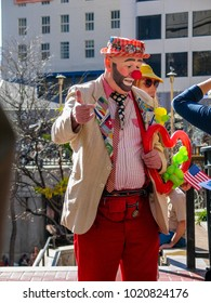 SAN FRANCISCO, CA, USA -  NOV 12, 2007: A unidentified man dressed clown amuse people near cable car route terminal at Powell street on Nov 12, 2007 in San Francisco.