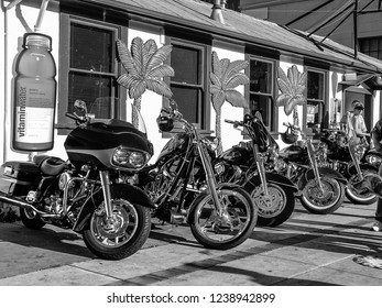 SAN FRANCISCO, CA, USA -  NOV 12, 2007: The parking of black motorbikes on the street near little café in San Francisco on Sept 22, 2010.