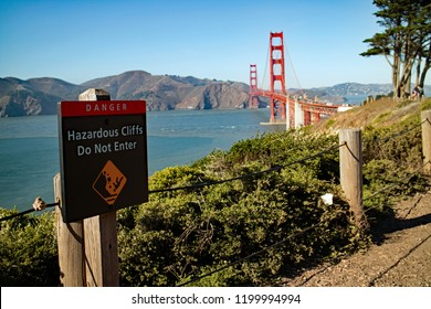 San Francisco, CA. USA - October 8, 2018: Sign warning of steep cliffs near Golden Gate bridge.