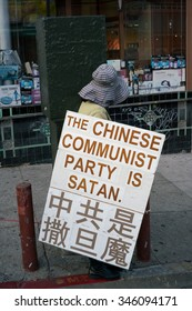 San Francisco, CA, USA -- Sep 23, 2015.  A woman in San Francisco's Chinatown protests against the Chinese Communist Party.