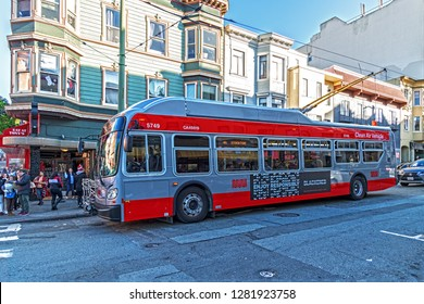 San Francisco California 2018 12 30  minibus clean air vehicle stopped at Stockton and Union streets in the background is Tony's Pizza Napoletana pizzeria