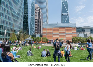 San Francisco, California - August 11, 2018: At the Salesforce Transit Center's grand opening, people mingle on the grass listening to music.