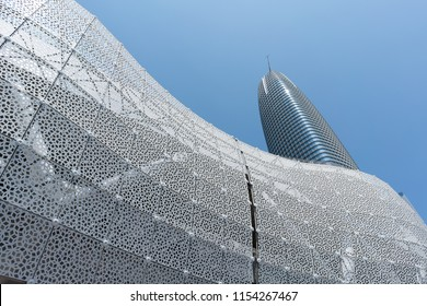 San Francisco, California - August 11, 2018: The Salesforce Tower is visible rising behind the Salesforce Transit Center at the public opening of the Transit Center.
